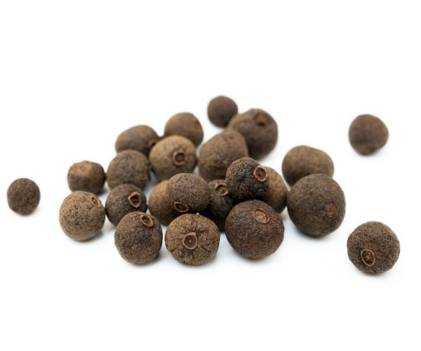 Scattered allspice isolated on white background